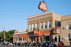 Irma, the legendary hotel of Buffalo Bill in Cody, USA. Irma, the legendary Hotel in Cody with a lot of motorbikes in front . Buffalo Bill built the hotel in stock photography