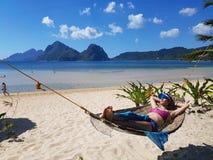 Irma lying on a hammock Stock Photography