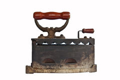 Iron. A vintage rusty carborn heated iron Stock Image
