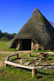 Iron age round house. A reconstructed round house located in an iron age hill fort in  Pembrokeshire Wales Royalty Free Stock Photos