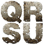 Iron alphabet. Iron letters with torn edge isolated on white background (series Stock Photos