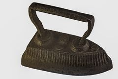 Iron, antique. An antique iron made of metal, never breaks Stock Images