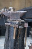 Iron anvil. Antique iron anvil in a medieval exhibition Stock Photography