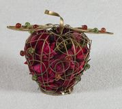 Iron apple sachet with dried flowers Royalty Free Stock Photography