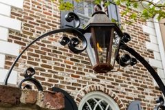 Gas Lantern Archway Porch Lights. Iron arch over entrance gate lit by vintage gas lantern Royalty Free Stock Images