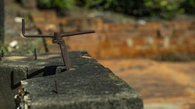 Iron arrows in one directions are isolated on a blurred background. Iron object looking like an arrow. stock image