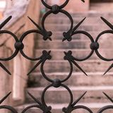 Iron artistic grid. The details of an ancient iron artistic grid Royalty Free Stock Photo