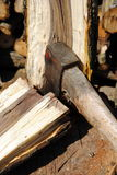 Iron axe chop wood trunk. With wood logs on background Royalty Free Stock Image