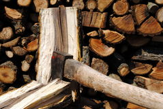 Iron axe chop wood trunk. With wood logs on background Royalty Free Stock Photography