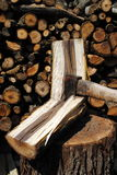 Iron axe chop wood trunk. With wood logs on background Stock Images