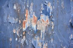 Iron background painted blue paint with cracks scratches and rust. Steel background. Iron background painted with blue paint with cracks scratches and rust stock photo