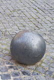 Iron ball on cobblestone Royalty Free Stock Images