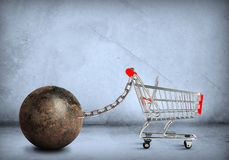 Iron ball with shopping cart Royalty Free Stock Images