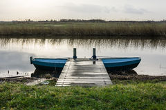 Iron barge at a pier in the polder Royalty Free Stock Photo