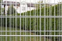 Iron bars of an empty gabion wall Stock Photo