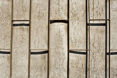 Iron bars in front off pealing wall Royalty Free Stock Images