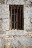 Iron bars in old stone jail Stock Images
