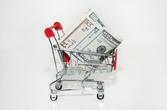 An iron basket of money. Purchases in cash stock image