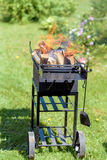 Iron  BBQ grill with flame Royalty Free Stock Photos