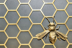 Iron bee. On a honeycomb Stock Photography