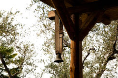 Iron bell. Hanging on the wall of a porch Royalty Free Stock Photography