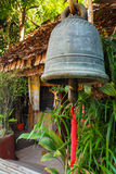 Iron bell with local bamboo house Royalty Free Stock Image