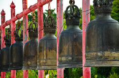 The iron bell on the Red pillar. Old Bell on a pillar Royalty Free Stock Photo