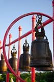 The iron bell on the Red pillar. Old Bell on a pillar Royalty Free Stock Image