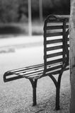 An iron bench , empty and in black and white Stock Photo