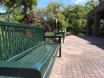 Iron bench in the park royalty free stock photo
