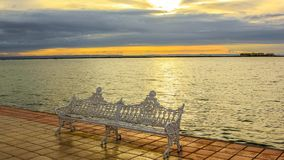 La Paz waterfront Cinemagraph. Iron bench on the waterfront of the La Paz, Mexico, Baja California Sur, at sunset. Cinemagraph loop background stock video