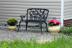 Iron bench in the yard Royalty Free Stock Image