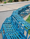 Iron benches painted with skyblue paint. Rusty Iron benches painted with skyblue in the park stock images