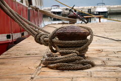 Iron bollard with rope , Croatia Stock Image