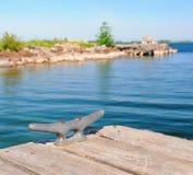 Iron bollard. On wooden pier Stock Photos