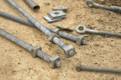 Iron bolts and knots. Bolts and knots on the ground Royalty Free Stock Photography