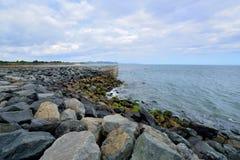 Iron-bound rock stone coast Stock Image