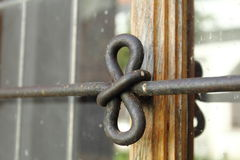 Iron bow. As a accessory on the old church window Royalty Free Stock Photography