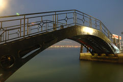Iron bridge. It is an ancient iron bridge in Venice, Italy. It is very beautiful in the light at night royalty free stock photos
