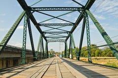 Iron bridge. Green Bridge, a wooden floor Royalty Free Stock Photo
