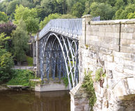 The Iron Bridge. Crossing the River Severn, Ironbridge Gorge, Shropshire, England royalty free stock image