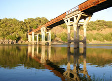 Iron bridge. A Iron Bridge reflected into a lake - Sardinia, Italy Royalty Free Stock Image