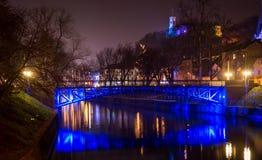Iron bridge across a river Stock Image