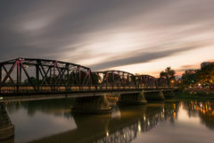 Iron bridge across river. In Thailand royalty free stock photography
