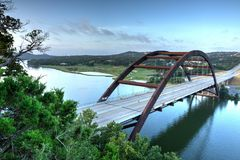 Iron Bridge in Austin, Texas. The iconic 360 Bridge in west Austin that spans Lake Austin. In the background you can see Austin Country Club and downtown Austin stock image