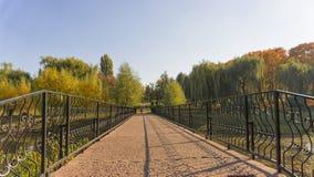 Iron bridge in an autumn park. reflect off a pond royalty free stock photos