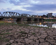 Iron bridge and dry soil near the river, Thailand Stock Images