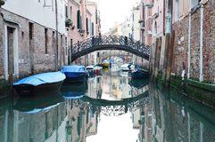 Iron bridge and green water in Venice Royalty Free Stock Photo