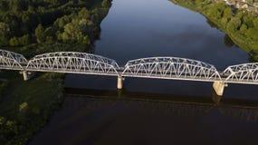 Iron bridge over the river aerial drone stock image