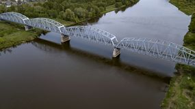 Iron bridge over the river view from the drone royalty free stock photos